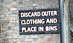Discard outer clothing and place in bins